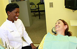 Dr. Carol Felder smiling and talking to a female patient