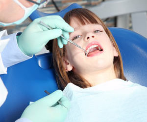 young girl getting her teeth cleaned