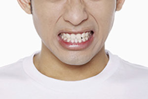 close-up of young man grinding his teeth